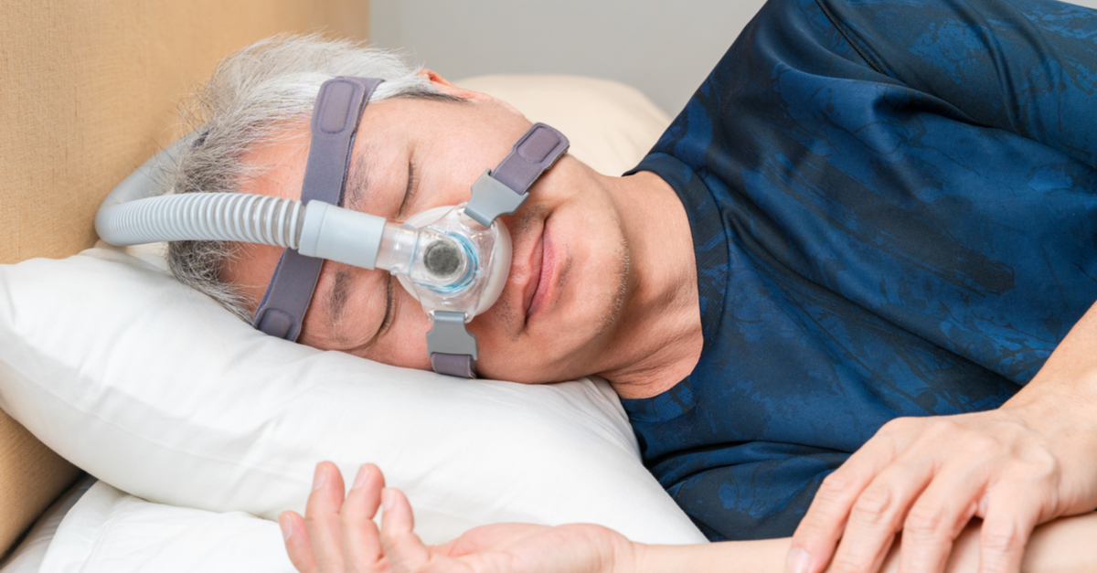 man sleeping with cpap and alternative oral appliances