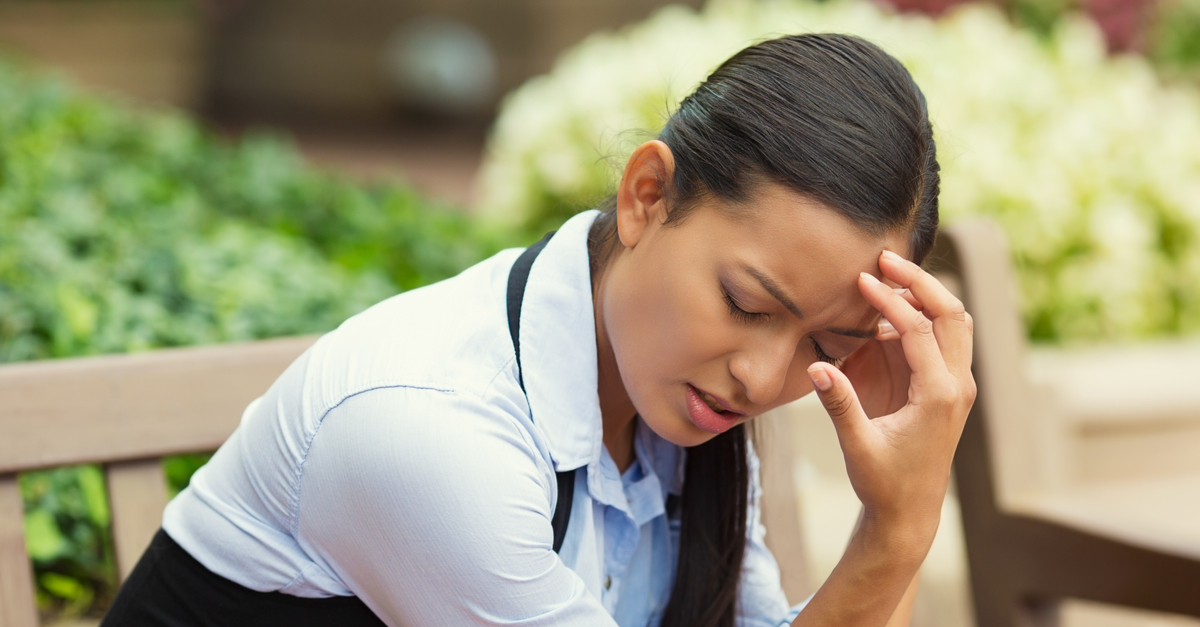 woman suffering from unexplained headache